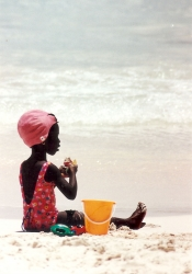 Oisitns • girl on beach w. fruit