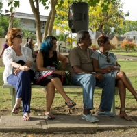 Gathered on a bench in Queen's Park, Bridgetown for Green Readings 2013, Part 1.